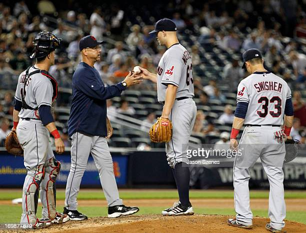 Justin Masterson of the Cleveland Indians hands the ball to manager Terry Francona of the Cleveland Indians as he's taken out of the ball game...