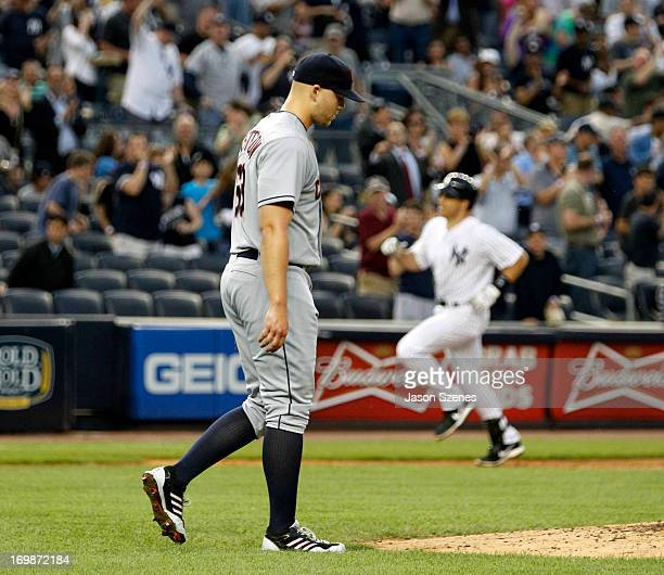 Justin Masterson of the Cleveland Indians reacts after giving up a grand slam to Mark Teixeira of the New York Yankees in the third inning at Yankees...