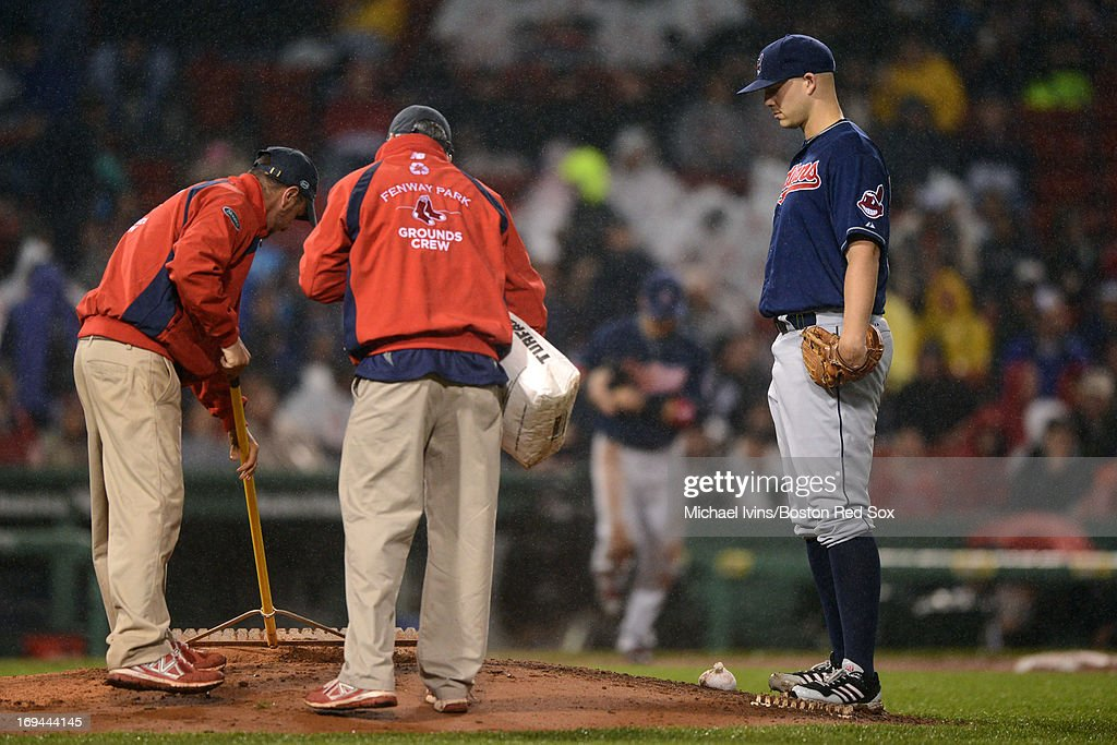 Justin Masterson #63 of the Cleveland Indians waits for the grounds crew to finish drying off the mound before facing the Boston Red Sox in the fourth inning on May 24, 2013 at Fenway Park in Boston, Massachusetts.