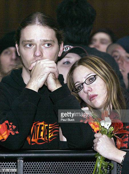Justin Mauro and Betty Herrin of Orland Florida listen to speakers during memorial service for slain rocker Dimebag Darrell Abbott at the Arlington...