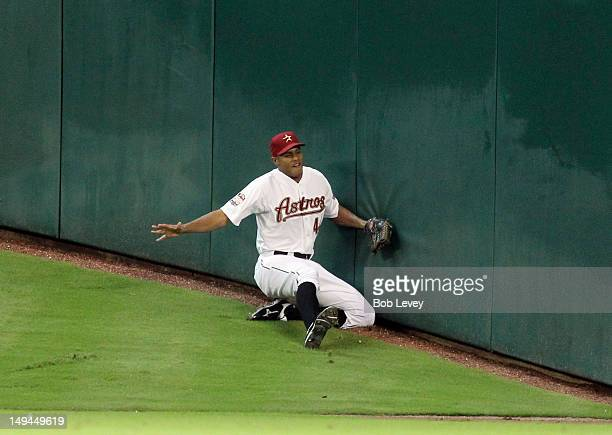 Justin Maxwell of the Houston Astros attempts to make a catch on Tal's Hill in center field on a ball hit by Garrett Jones of the Pittsburgh Pirates...