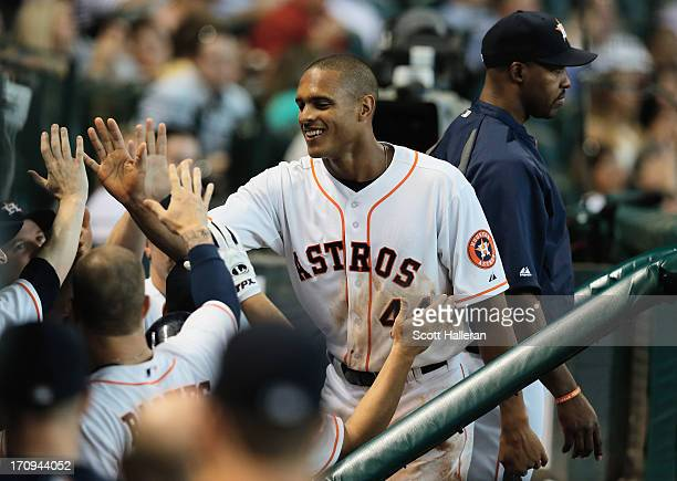 Justin Maxwell of the Houston Astros celebrates in the dugout after scoring a run in the fifth inning during the game against the Milwaukee Brewers...