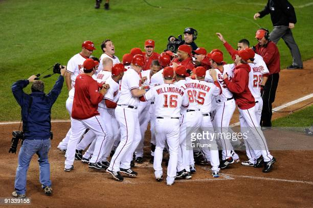 Justin Maxwell of the Washington Nationals celebrates with teammates after hitting a walkoff grand slam in the ninth inning against the New York Mets...