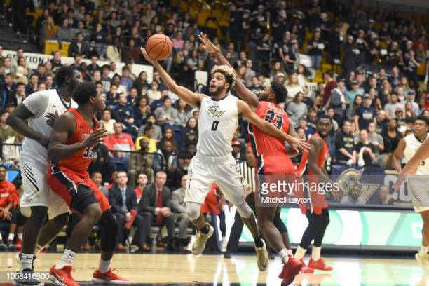Justin Mazzulla of the George Washington Colonials derives to the basket over Andrew Garcia of the Stony Brook Seawolves during a college basketball...