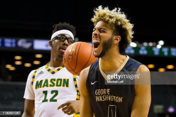 Justin Mazzulla of the George Washington Colonials reacts in front of AJ Wilson of the George Mason Patriots during the second round of the Atlantic...