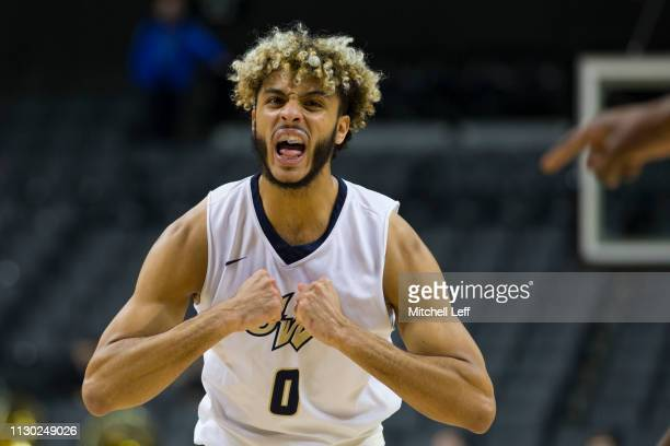 Justin Mazzulla of the George Washington Colonials yells out to his team against the Massachusetts Minutemen in the first round of the Atlantic 10...