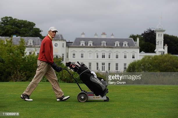 Justin McCarthy of Ashbourne Golf Club walks past the K Club hotel during the Virgin Atlantic PGA National ProAm Championship Regional Final at the K...