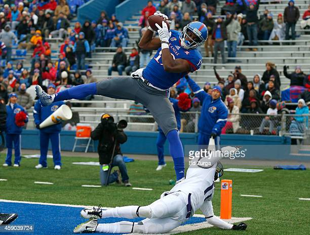 Justin McCay of the Kansas Jayhawks catches a ball in the end zone but steps out for in incomplete pass against Ranthony Texada of the TCU Horned...