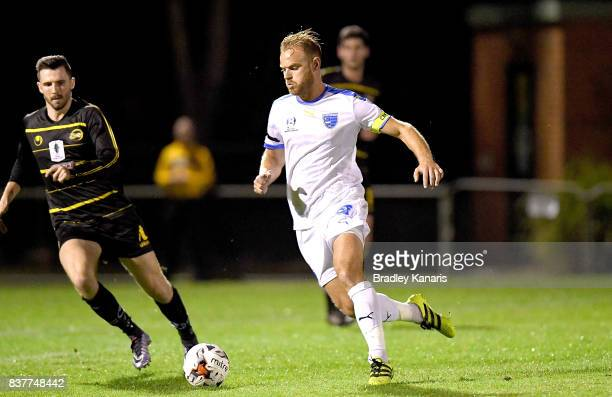 Justin McKay of Gold Coast City breaks away from the defence during the FFA Cup round of 16 match between Moreton Bay United and Gold Coast City at...