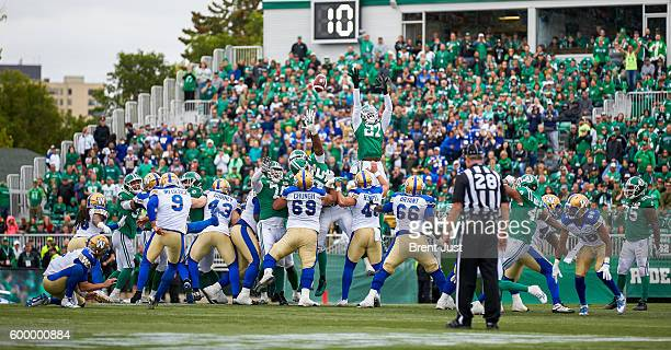 Justin Medlock of the Winnipeg Blue Bombers kicks the game winning field goal with no time left on the clock in the game between the Winnipeg Blue...