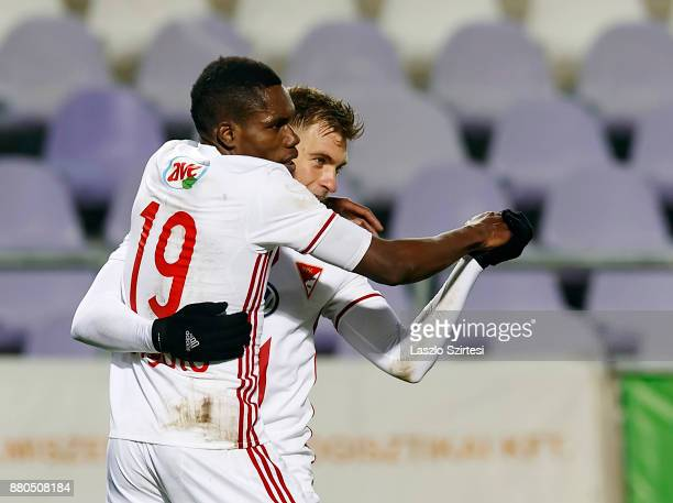 Justin Mengolo of DVSC celebrates his goal and dances the tango with Balazs Benyei of DVSC during the Hungarian OTP Bank Liga match between Vasas FC...