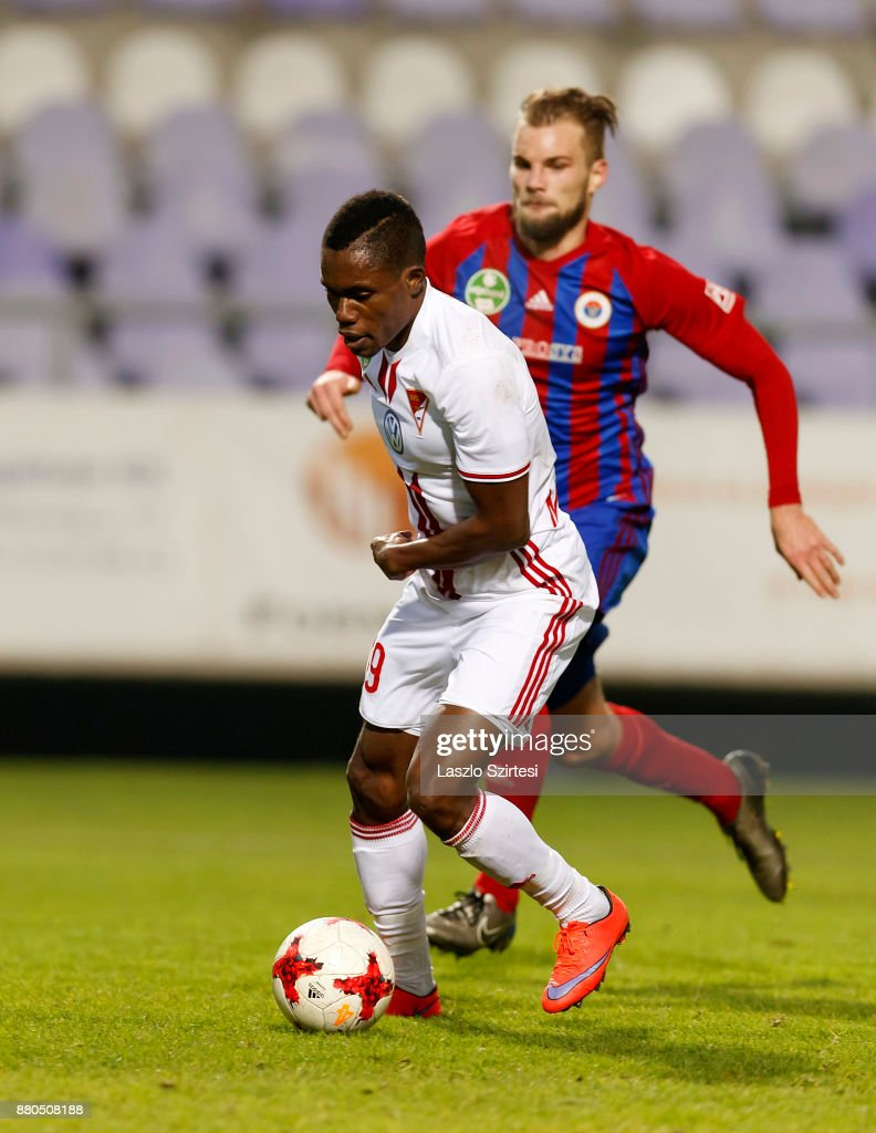 Justin Mengolo (L) of DVSC leaves Vit Benes (R) of Vasas FC behind during the Hungarian OTP Bank Liga match between Vasas FC and DVSC at Ferenc Szusza Stadium on November 25, 2017 in Budapest, Hungary.
