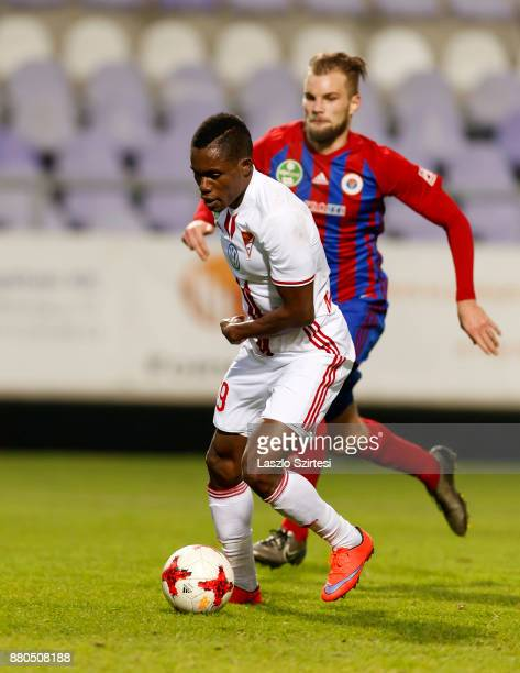 Justin Mengolo of DVSC leaves Vit Benes of Vasas FC behind during the Hungarian OTP Bank Liga match between Vasas FC and DVSC at Ferenc Szusza...