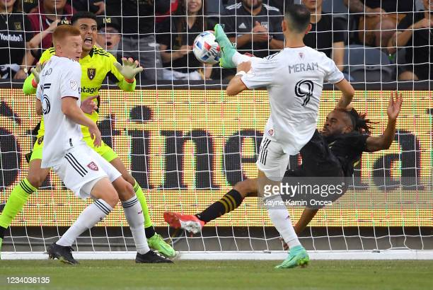Justin Meram and Justen Glad help defend as David Ochoa of Real Salt Lake blocks a shot by Raheem Edwards of Los Angeles FC in the first half of the...