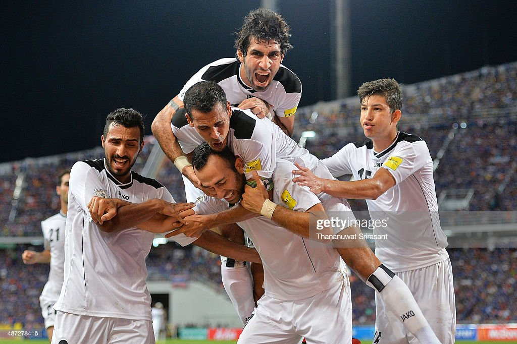 Justin Meram (C bottom) of Iraq celebrates scoring the first goal with teammates during the 2018 FIFA World Cup Qualifier match between Thailand and Iraq at Rajamangala Stadium on September 8, 2015 in Bangkok, Thailand.