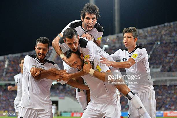 Justin Meram of Iraq celebrates scoring the first goal with teammates during the 2018 FIFA World Cup Qualifier match between Thailand and Iraq at...
