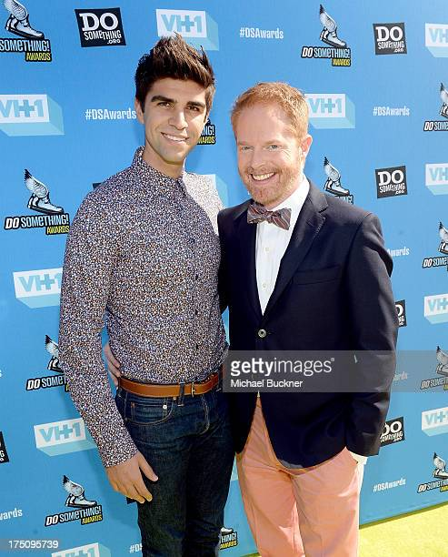 Justin Mikita and actor Jesse Tyler Ferguson arrive at the DoSomethingorg and VH1's 2013 Do Something Awards at Avalon on July 31 2013 in Hollywood...