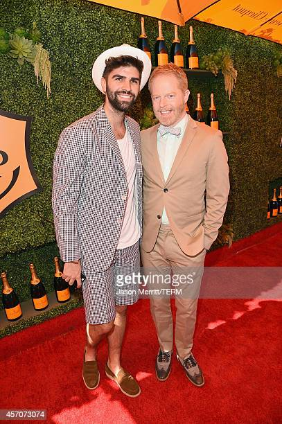 Justin Mikita and actor Jesse Tyler Ferguson attend the FifthAnnual Veuve Clicquot Polo Classic at Will Rogers State Historic Park on October 11 2014...
