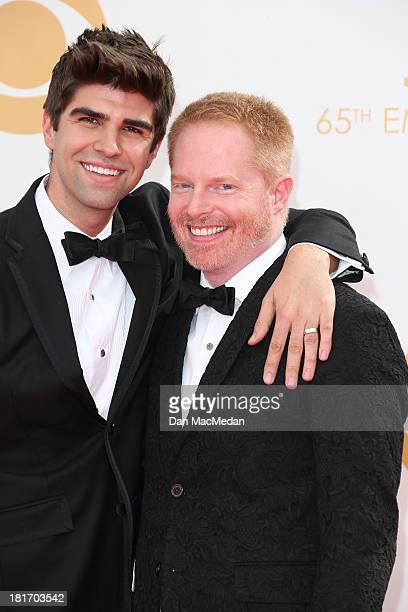 Justin Mikita and Jesse Tyler Ferguson arrive at the 65th Annual Primetime Emmy Awards at Nokia Theatre LA Live on September 22 2013 in Los Angeles...