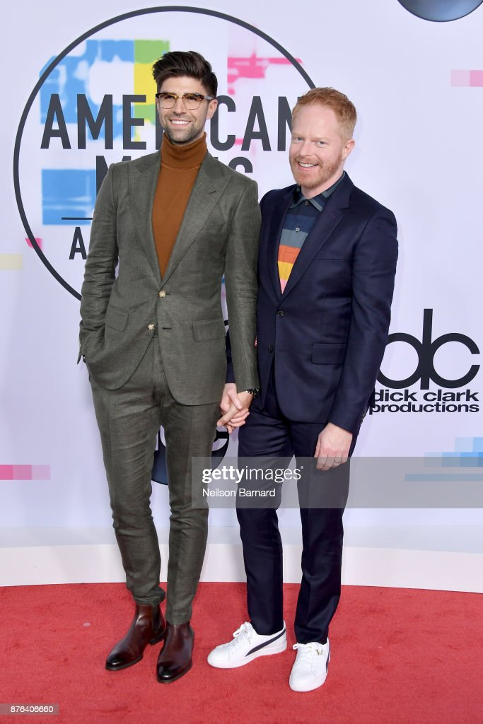 Justin Mikita (L) and Jesse Tyler Ferguson attend the 2017 American Music Awards at Microsoft Theater on November 19, 2017 in Los Angeles, California.