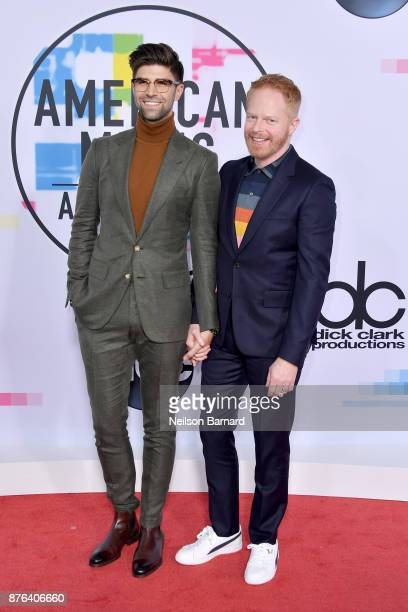 Justin Mikita and Jesse Tyler Ferguson attend the 2017 American Music Awards at Microsoft Theater on November 19 2017 in Los Angeles California