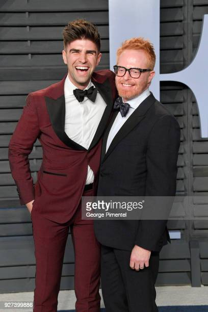 Justin Mikita and Jesse Tyler Ferguson attend the 2018 Vanity Fair Oscar Party hosted by Radhika Jones at Wallis Annenberg Center for the Performing...