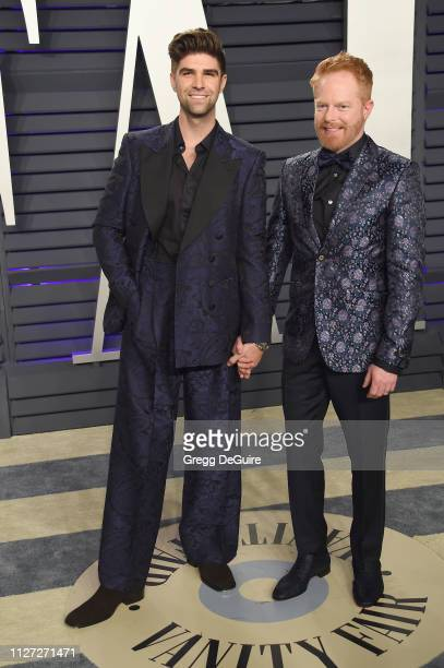 Justin Mikita and Jesse Tyler Ferguson attend the 2019 Vanity Fair Oscar Party hosted by Radhika Jones at Wallis Annenberg Center for the Performing...