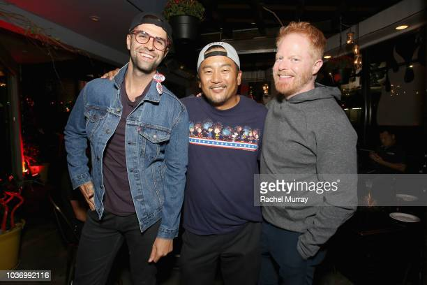 Justin Mikita Roy Choi and Jesse Tyler Ferguson attend The Flamin Hot Spot Cheetos new limitedtime restaurant with a menu inspired by chef Roy Choi...
