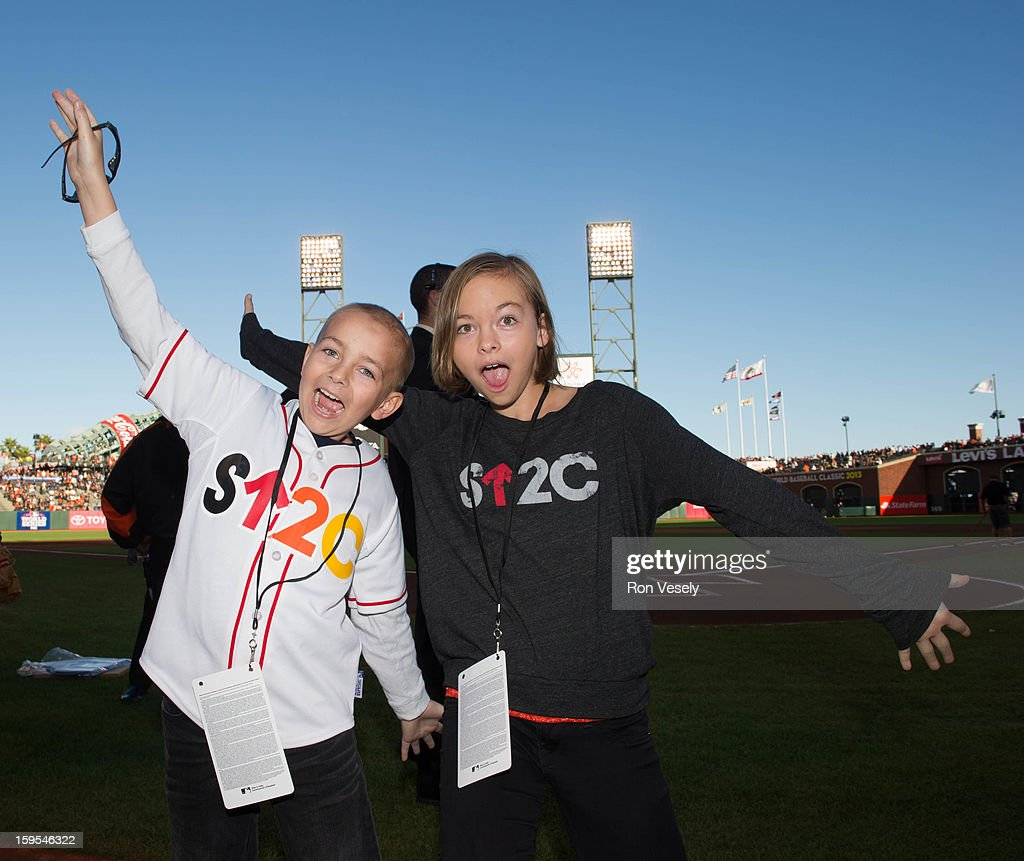 Justin Miller and his sister Kelly Miller pose for a photograph before Game One of the 2012 World Series between the Detroit Tigers and the San Francisco Giants on October 24, 2012 at AT&T Park in San Francisco, California.