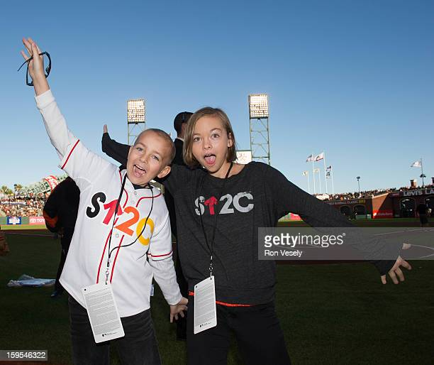 Justin Miller and his sister Kelly Miller pose for a photograph before Game One of the 2012 World Series between the Detroit Tigers and the San...
