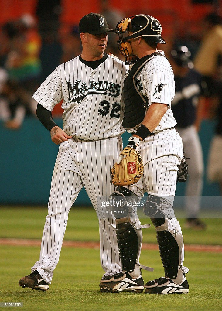 Justin Miller #32 of the Florida Marlins is congratulated by catcher Matt Treanor #20 after defeating the Milwaukee Brewers at Dolphin Stadium on May 8, 2008 in Miami, Florida. The Marlins defeated the Brewers 7-2.
