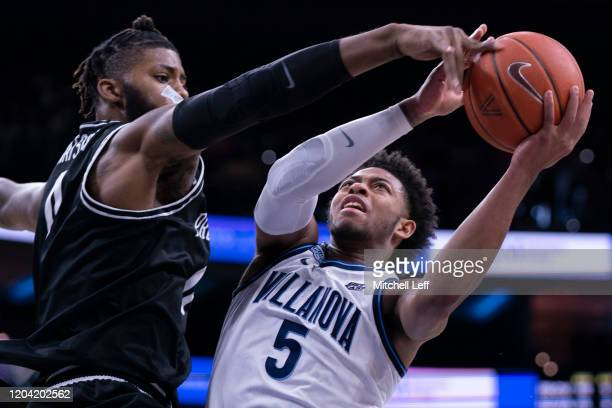 Justin Moore of the Villanova Wildcats goes up for a shot against Nate Watson of the Providence Friars in the first half at the Wells Fargo Center on...