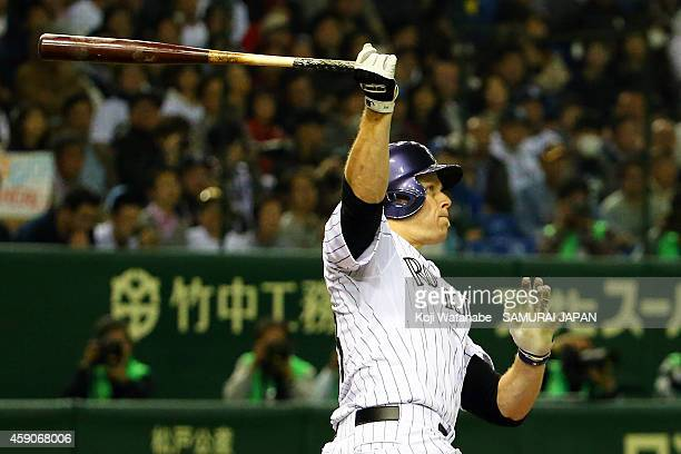 Justin Morneau of the Colorado Rockies hits a three-run homer in the third inning during the game four of Samurai Japan and MLB All Stars at Tokyo...