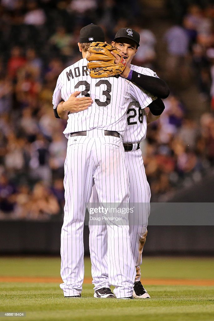 Justin Morneau #33 and Nolan Arenado #28 of the Colorado Rockies celebrate their 2-1 victory over the San Francisco Giants at Coors Field on September 4, 2015 in Denver, Colorado.
