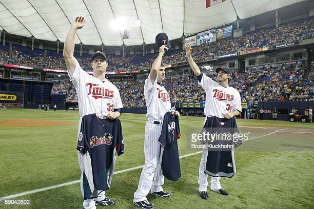 Justin Morneau Joe Mauer and Joe Nathan of the Minnesota Twins salute the crowd with their AllStar jerseys prior to the game against the Chicago...