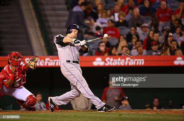 Justin Morneau of the Colorado Rockies breaks his bat during his at-bat in the sixth inning during the MLB game against the Los Angeles Angels of...