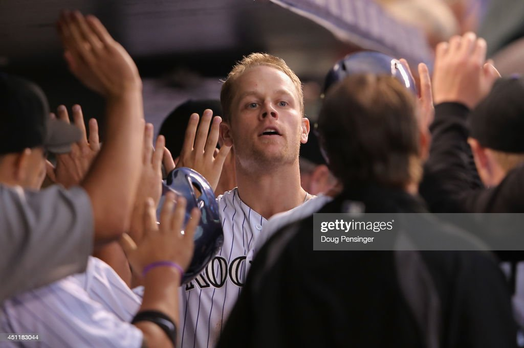 Justin Morneau #33 of the Colorado Rockies celebrates his three run home run off of Nick Greenwood #62 of the St. Louis Cardinals to give the Rockies a 6-4 lead in the fourth inning at Coors Field on June 24, 2014 in Denver, Colorado.