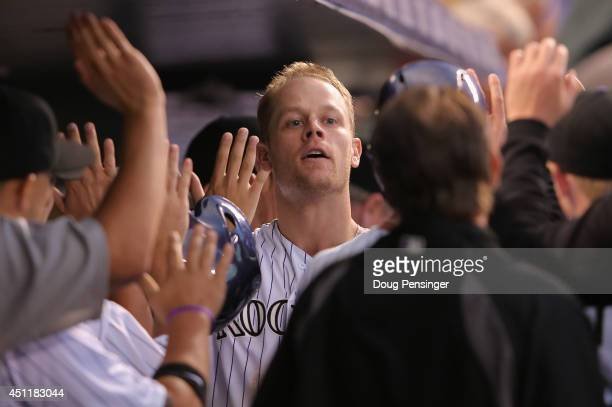 Justin Morneau of the Colorado Rockies celebrates his three run home run off of Nick Greenwood of the St Louis Cardinals to give the Rockies a 64...