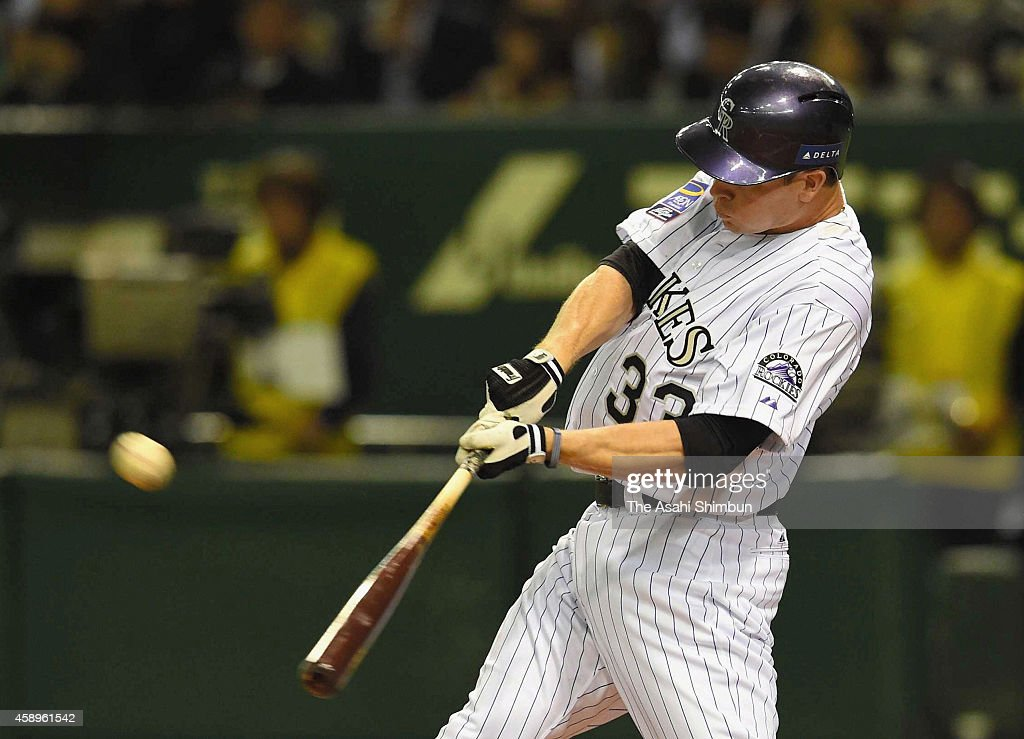 Justin Morneau #33 of the Colorado Rockies hits a two-run homer in the bottom of 2nd inning during the game two of Samurai Japan and MLB All Stars at Tokyo Dome on November 14, 2014 in Tokyo, Japan.