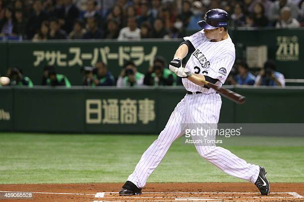 Justin Morneau of the Colorado Rockies hits an RBI double in the first inning during the game four of Samurai Japan and MLB All Stars at Tokyo Dome...