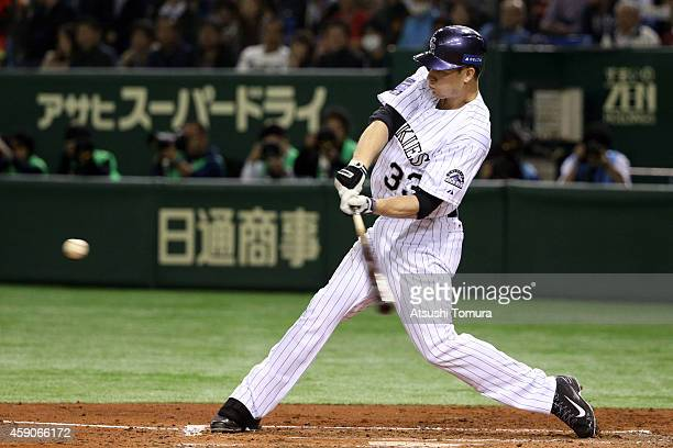 Justin Morneau of the Colorado Rockies hits three-run homer in the third inning during the game four of Samurai Japan and MLB All Stars at Tokyo Dome...