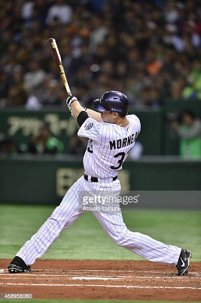 Justin Morneau of the Colorado Rockies hits tworun homer in the second inning during the game two of Samurai Japan and MLB All Stars at Tokyo Dome on...