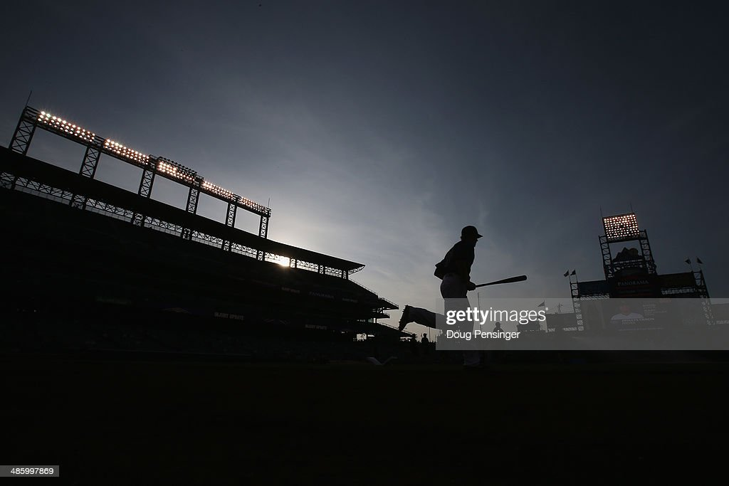 Justin Morneau #33 of the Colorado Rockies takes the field to warm up prior to facing the San Francisco Giants at Coors Field on April 21, 2014 in Denver, Colorado. The Rockies defeated the Giants 8-2.
