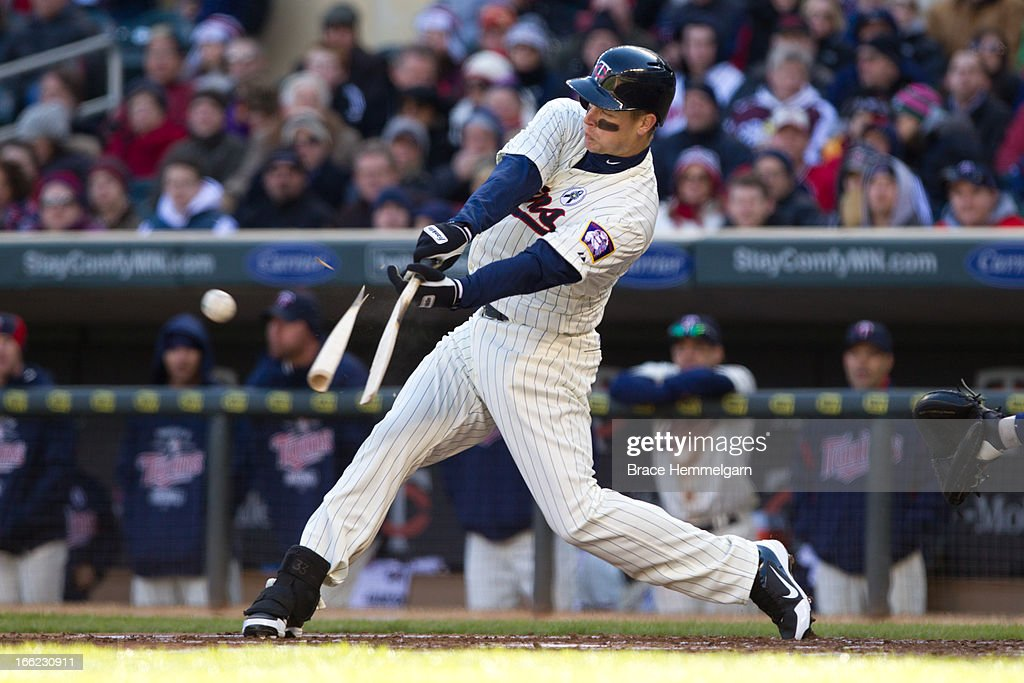 Justin Morneau #33 of the Minnesota Twins breaks his bat against the Detroit Tigers on April 1, 2013 at Target Field in Minneapolis, Minnesota. The Tigers defeated the Twins 4-2.