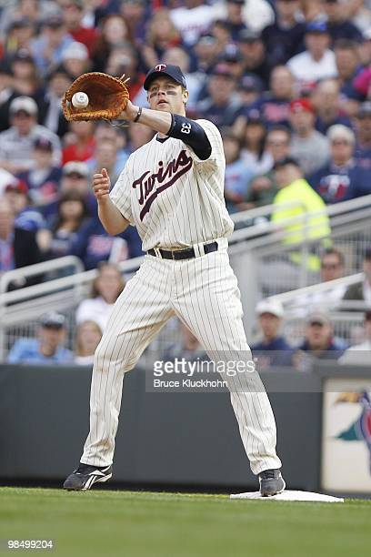 April 12: Justin Morneau of the Minnesota Twins catches a throw to put out a member of the Boston Red Sox on April 12, 2010 at Target Field in...