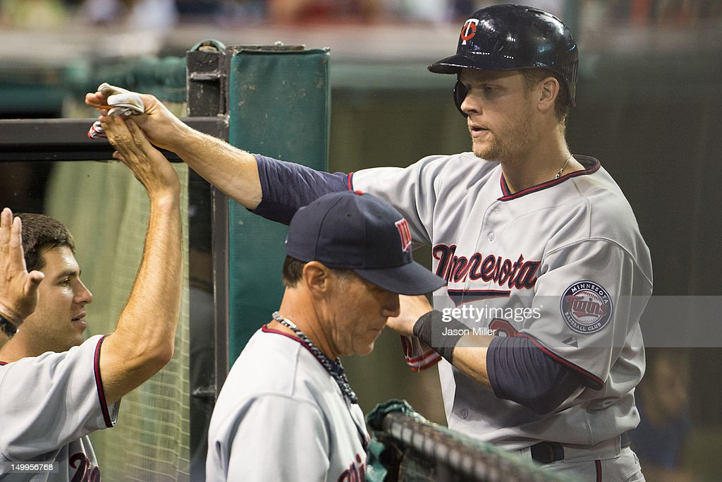 Justin Morneau #33 of the Minnesota Twins celebrates after scoring the go-ahead run during the ninth inning against the Cleveland Indians at Progressive Field on August 7, 2012 in Cleveland, Ohio.