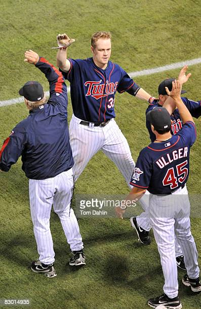 Justin Morneau of the Minnesota Twins celebrates following a Twins win against the Chicago White Sox at the Hubert H. Humphrey Metrodome September...