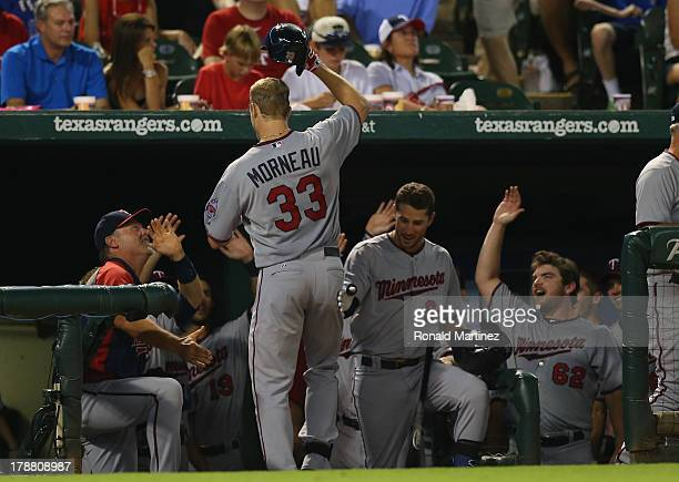 Justin Morneau of the Minnesota Twins celebrates hitting a homerun against the Texas Rangers in the 7th inning at Rangers Ballpark in Arlington on...