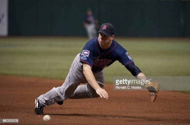 Justin Morneau of the Minnesota Twins dives for a ball during a game against the Tampa Bay Rays at Tropicana Field on May 29 2009 in St Petersburg...