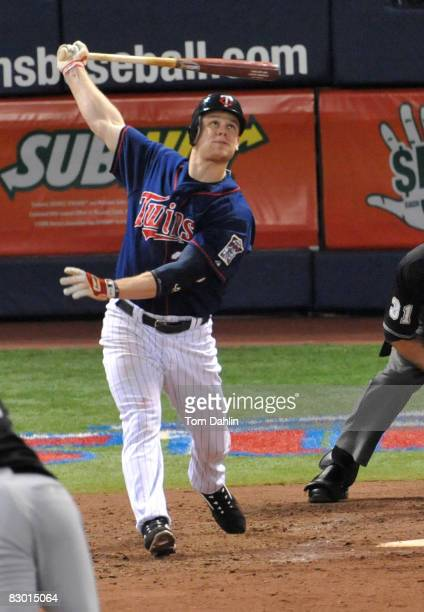 Justin Morneau of the Minnesota Twins follows through after a hit during an MLB game against the Chicago White Sox at the Hubert H. Humphrey...